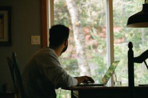 Man working from home using computer
